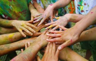 hands teamwork corporate team building