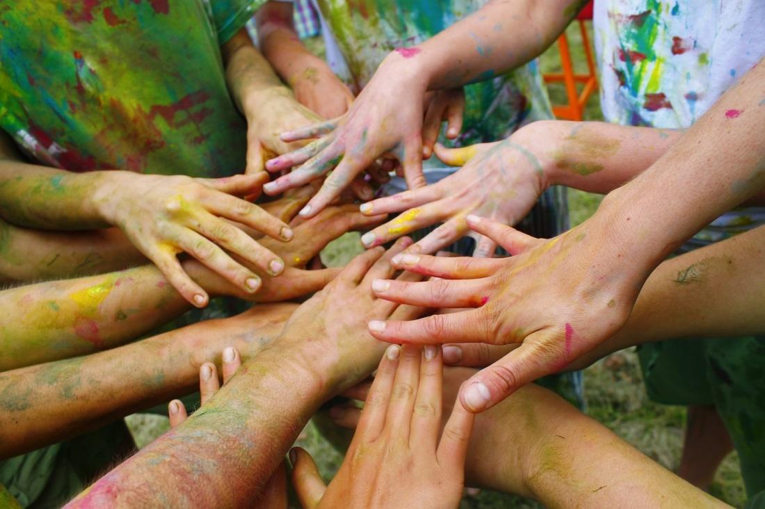 hands teamwork corporate team building
